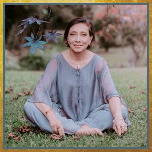 Ana sitting in grass